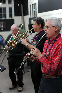 Dick Cooley, right, Mark Santarelly and Dan Epperson play at the Fremont Center of the Arts' Mardi Gras party on Saturday. The Arkansas River Dixie Band played music and an authentic New Orleans dinner was served to raise funds for the Center's building operations. They raised about $1,000. Brandon Hopper/Daily Record