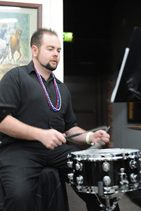 Ethan McCarter plays the drums at the Fremont Center of the Arts' Mardi Gras party on Saturday. The Arkansas River Dixie Band played and an authentic New Orleans dinner was served to raise funds for the Center's building operations. They raised about $1,000. Brandon Hopper/Daily Record
