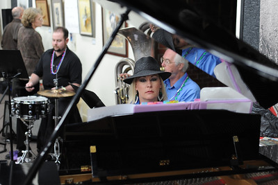 Suzanne Tanner plays the piano play at the Fremont Center of the Arts' Mardi Gras party on Saturday. The Arkansas River Dixie Band played and an authentic New Orleans dinner was served to raise funds for the Center's building operations. They raised about $1,000. Brandon Hopper/Daily Record