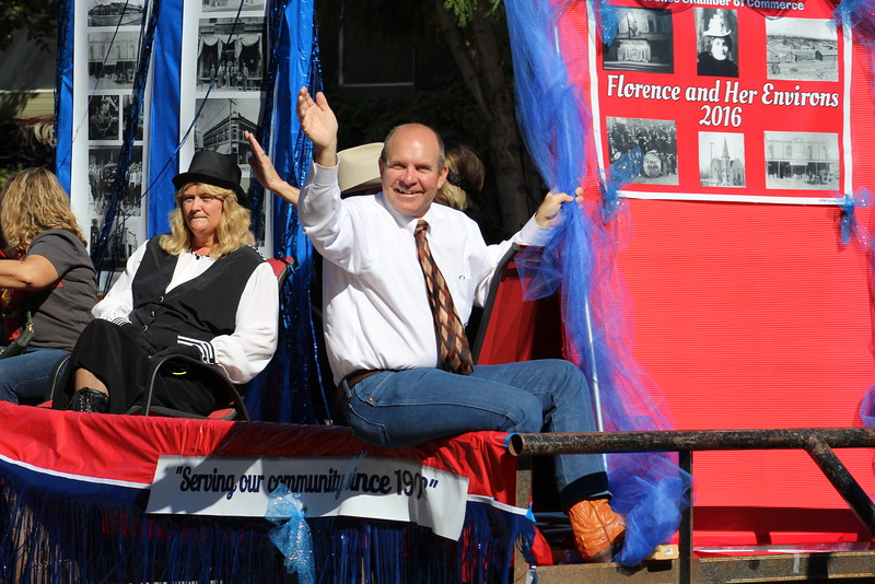 An official from the Florence Chamber of Commerce waves during the Pioneer Day parade.