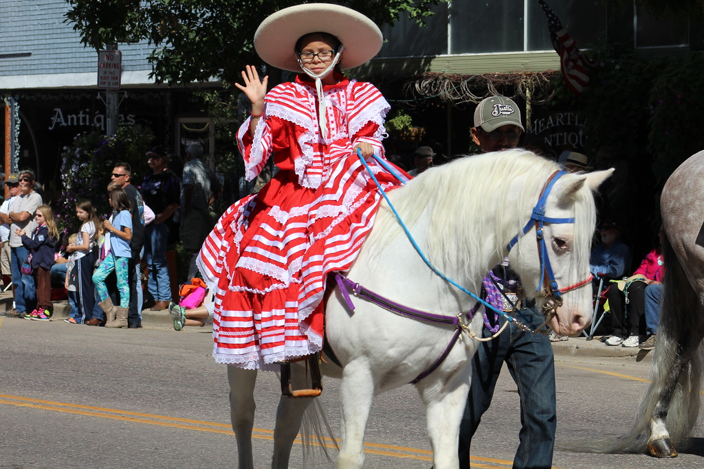 . A girl rides by in the Pioneer Day Parade.