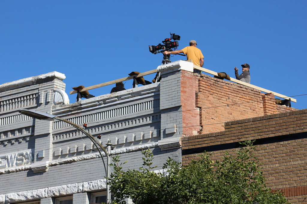 ". Filmmakers from the Netflix film ""Our Souls at Night\"" set up on a building on Florence\'s Main Street."