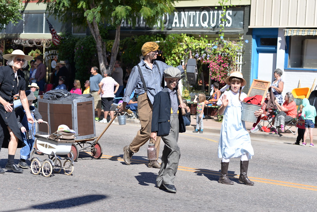 . A family depicts Florence\'s mining days during the Pioneer Day Parade.