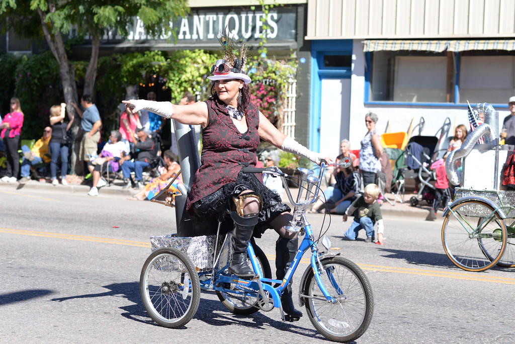 . A steampunk entry rides by in the parade.