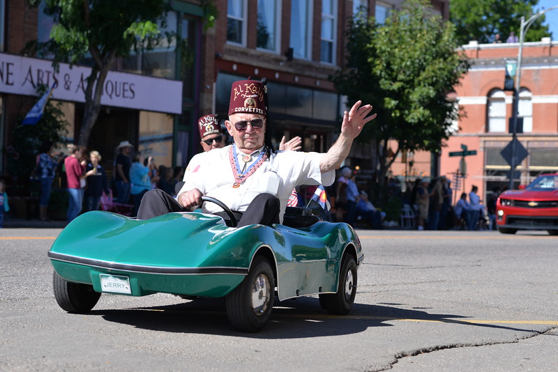 A shriner passes by in the Pioneer Day Parade.