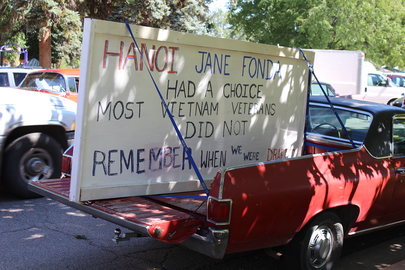 A protestor sets up shop just a few blocks away from the Pioneer Day Parade.  Officials said Jane Fonda and Robert Redford weren't at the parade.