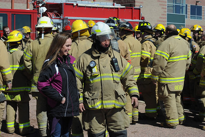 Charmin Heimel, left, and Florence Fire Chief Gary McWilliams look on during the fire training on Sunday. Brandon Hopper/Daily Record