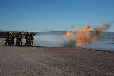 Canon City firefighters fight a propane fire during a training session at Florence High School on Sunday. Brandon Hopper/Daily Record