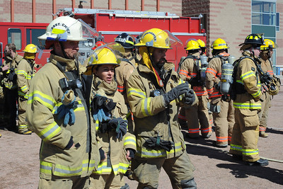 Firefighters look on during the fire training on Sunday. Brandon Hopper/Daily Record