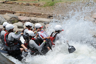 The Red Ladies, led by team captain and Cotopaxi woman Julie Sutton, in white bib, paddles down the Arkansas River on Friday at the Royal Gorge Whitewater Festival. The festival continues today at Centennial Park. Brandon Hopper/Daily Record