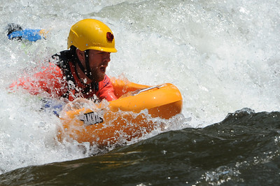 Canon City man Phil Kirkman rides his riverboard during the Royal Gorge Whitewater Festival on Friday at Centennial Park. Brandon Hopper/Daily Record