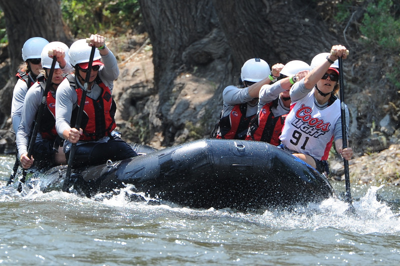 The Red Ladies, led by team captain and Cotopaxi woman Julie Sutton, far right, paddles down the Arkansas River on Friday at the Royal Gorge Whitewater Festival. The festival continues today at Centennial Park. Brandon Hopper/Daily Record