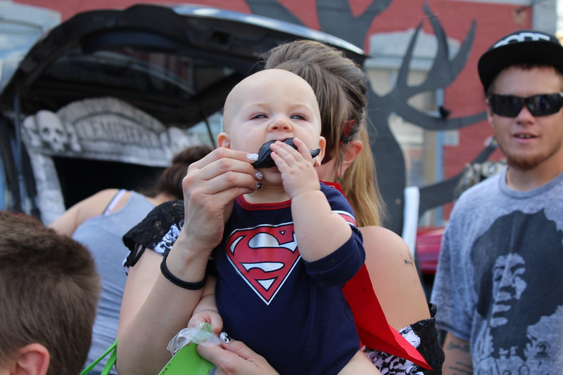 Treber Perry, 7 months, moves through line with his family at Spook-Tacular and Trunk or Treat.
