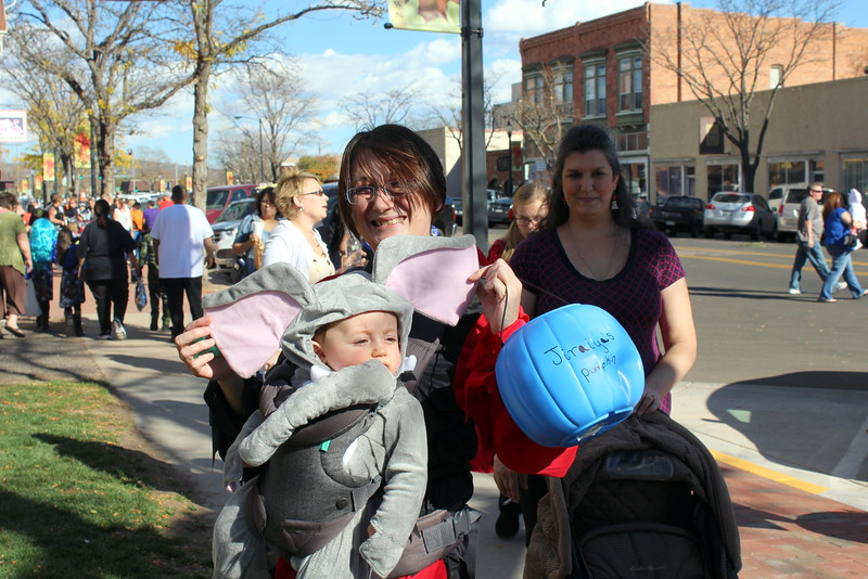 Jiraiya Mercer, 9 months, poses for a photo with Amanda Herrera at the Spook-Tacular and Trunk or Treat cosume contest.