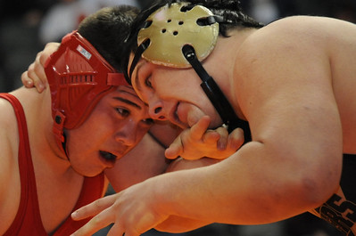 Tigers junior Garrett Benell wrestles Pueblo Centennial's Damian Garcia on Friday at the Class 4A state wrestling tournament at Pepsi Center in Denver. Brandon Hopper/Daily Record