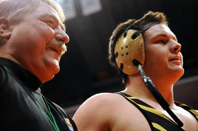 Tigers coach Duff Seaney, left, and Garrett Benell embrace after Benell's semifinal win against Pueblo Central's Evan Lancelot on Friday during the Class 4A state wrestling tournament at Pepsi Center in Denver. Brandon Hopper/Daily Record