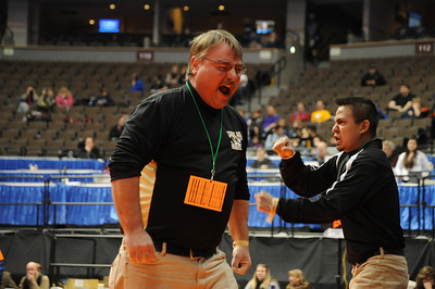 Tigers coaches Duff Seaney, left, and Erik Ortega celebrate after Garrett Benell semifinal win against Pueblo Central's Evan Lancelot on Friday during the Class 4A state wrestling tournament at Pepsi Center in Denver. Brandon Hopper/Daily Record