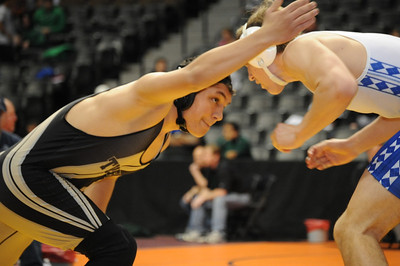 Tigers junior Anthony Abbott wrestles Broomfield's Luke McAnich on Friday in a first-round consolation match during the Class 4A state wrestling tournament at Pepsi Center in Denver. Abbott pinned McAnich to move on. Brandon Hopper/Daily Record
