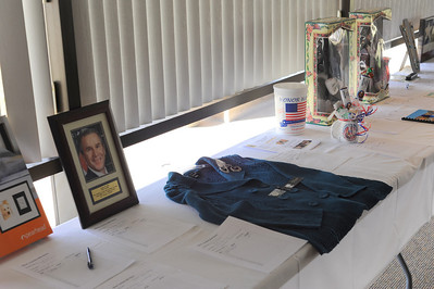 Some silent auction items for bidding on Sunday at the Lincoln Day Dinner put on by the Fremont County Republican Central Committee at the Holy Cross Abbey. Brandon Hopper/Daily Record