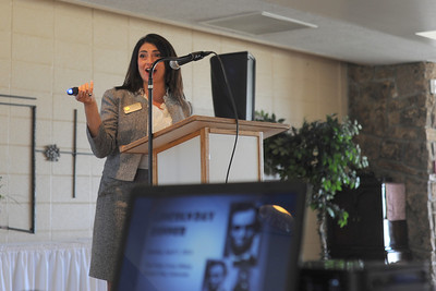 Representative Clarice Navarro shows the crowd her taser while she speaks on Sunday at the Lincoln Day Dinner put on by the Fremont County Republican Central Committee at the Holy Cross Abbey. Brandon Hopper/Daily Record