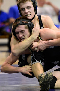 Huskies junior Jacob Yslas, bottom, scrambles for position against Salida's Jake Schoenfeld Thursday in Florence. Jeff Shane/ Daily Record