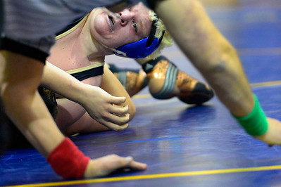 Huskies senior Conner Ward works for a pin against Salida's Jacob Wood Thursday in Florence. Jeff Shane/ Daily Record