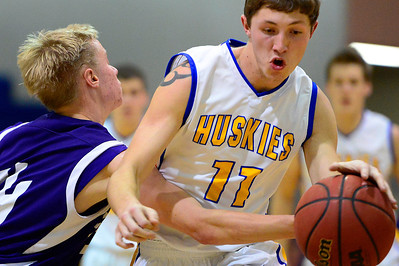 Huskies junior Dennis Donley, right, drives to the basket against Salida Thursday in Florence. Jeff Shane/ Daily Record