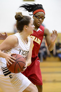 Tigers junior Erika O'Rourke, left, looks to pass Tuesday against Coronado's Tatianna Clanton in the Tiger Dome. Jeff Shane/ Daily Record