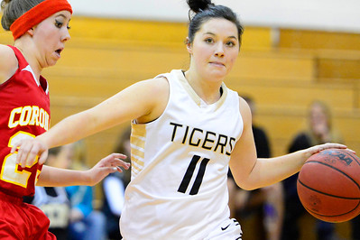 Tigers sophomore Kaylan Miller, right, looks to pass Tuesday against Coronado's Ceara Combs in the Tiger Dome. Jeff Shane/ Daily Record