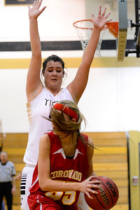 Tigers junior Lindsey Schwab, top, guards Coronado's Gabrielle Enole Tuesday in the Tiger Dome. Jeff Shane/ Daily Record