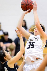 Tigers sophomore Nicole Archambeau, right, goes up for a shot against Pueblo South Friday in the Tiger Dome. Jeff Shane/ Daily Record