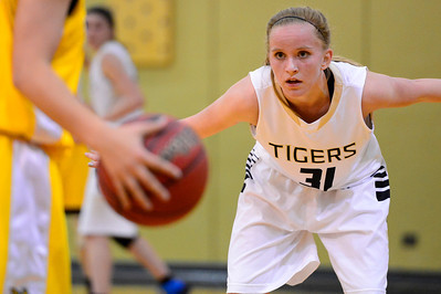 Tigers sophomore Emily Lambrecht stalks Pueblo East's Jailen Minich Friday in the Tiger Dome. Jeff Shane/ Daily Record
