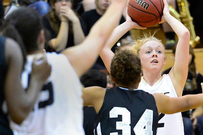 Tigers senior Nicole Decker, right, looks to pass against Pueblo South Friday in the Tiger Dome. Jeff Shane/ Daily Record