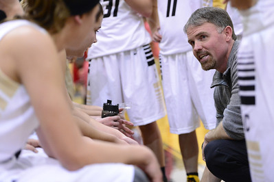 Tigers head girls basketball coach Dan Heath talks to players during a time out Tuesday against Coronado in the Tiger Dome. Jeff Shane/ Daily Record