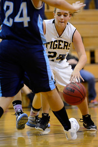 Tigers sophomore Danielle Hanenberg, right, dribbles through traffic against Widefield Wednesday in the Tiger Dome. Jeff Shane/ Daily Record