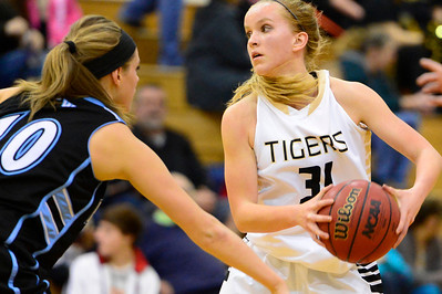 Tigers sophomore Emily Lambrecht looks to pass against Pueblo West Friday in the Tiger Dome. Jeff Shane/ Daily Record