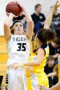 Tigers sophomore Nicole Archambeau, left, takes a shot Friday against Pueblo East in the Tiger Dome. Jeff Shane/ Daily Record