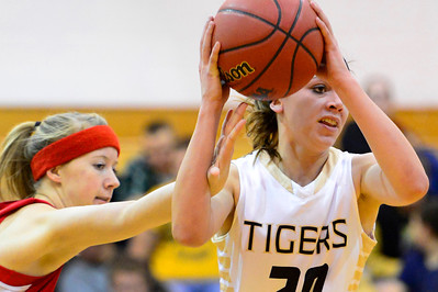 Tigers junior Amy Solis, right, looks to pass Tuesday against Coronado in the Tiger Dome. Jeff Shane/ Daily Record