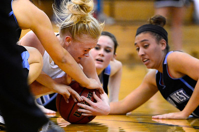 Tigers senior Nicole Decker, left, chases a lose ball against Pueblo West Friday in the Tiger Dome. Jeff Shane/ Daily Record