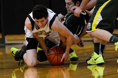 Tigers senior Evan Kerr, left, goes after a lose ball against Pueblo County Tuesday in the Tiger Dome. Jeff Shane/ Daily Record