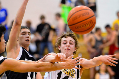 Tigers sophomore Jared Mews, right, passes Friday against Pueblo South in the Tiger Dome. Jeff Shane/ Daily Record