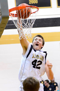 Tigers junior Gunner Javernick dunks against Pueblo County Tuesday in the Tiger Dome. Jeff Shane/ Daily Record