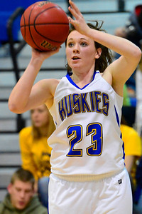 Husky senior Kenzie Gordon, left, goes up for a shot Monday against Bishop Machebeuf in Florence. Jeff Shane/ Daily Record