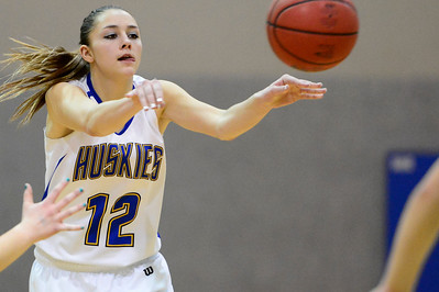Husky Taylor Holland against Manitou Springs. Jeff Shane/ Daily Record