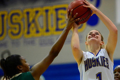 Husky Carly Chaney, right, goes up for a shot Monday against Bishop Machebeuf in Florence. Jeff Shane/ Daily Record