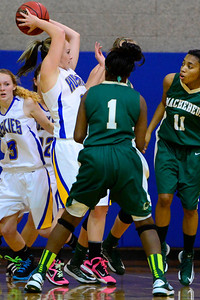 Husky Baylee Reeves, left, rebounds a ball Monday against Bishop Machebeuf in Florence. Jeff Shane/ Daily Record