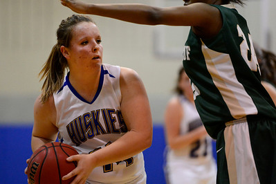 Husky Amanda Shade looks to pass Monday against Bishop Machebeuf in Florence. Jeff Shane/ Daily Record