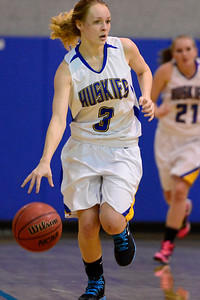 Husky Megan Droll drives down court Monday against Bishop Machebeuf in Florence. Jeff Shane/ Daily Record