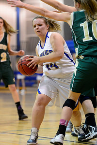 Husky Amanda Shade against Manitou Springs. Jeff Shane/ Daily Record