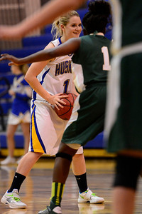 Husky Carly Chaney looks to pass Monday against Bishop Machebeuf in Florence. Jeff Shane/ Daily Record